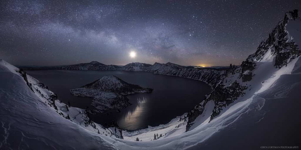 The moon and the Milky Way rise over the eastern horizon of Crater Lake on a frozen winter night. Prints available.